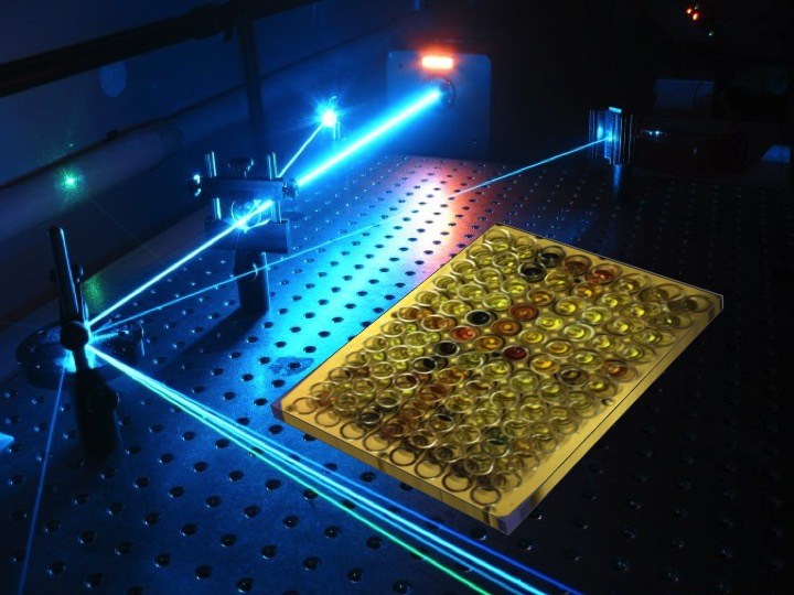 The image shows a laser experiment in a laboratory.